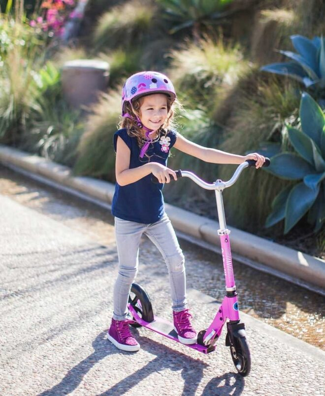 girl riding her micro scooter cruiser pink SA0170